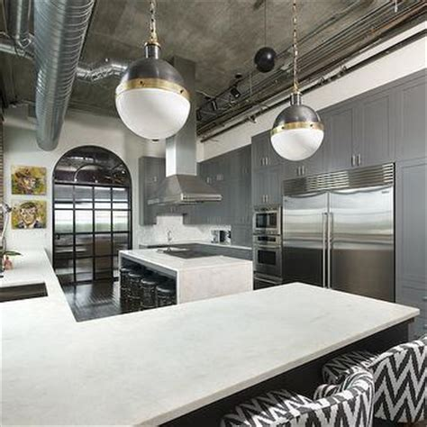 this inviting kitchen features flat front white cabinets gray flat front kitchen cabinets with white marble
