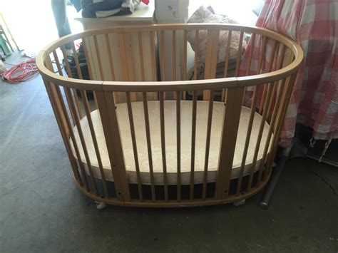 Brown Wooden Crib Letgo Brown Wooden Oval Crib In Flat Ca