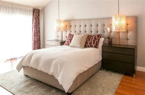Oversized Headboard by High End Hotel Styled Bedroom With An Oversized Tufted