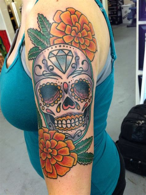 marigold tattoo traditional style marigolds and sugar skull i got