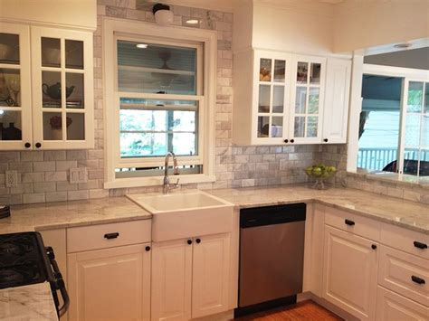 white kitchen cabinets with stainless steel appliances carrara marble grey gray and white kitchen with stainless