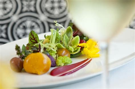 the dining room at the villa by barton g herloom vegetable salad at the dining room the villa by