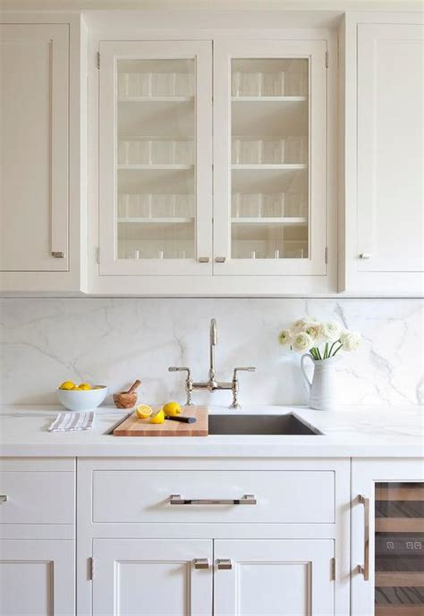 kitchen cabinets over sink sink with cutting boards transitional kitchen de