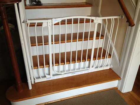 top of stairs baby gate with banister picture of baby gate for stairs with banister best baby
