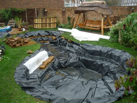 how to build a garden pond installing a preformed rigid
