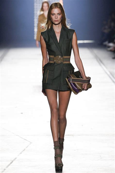 Who Wore Versace Best The Catwalk Model Or Schiffer by Ciara Shows Legs In Plunging Versace Vest And