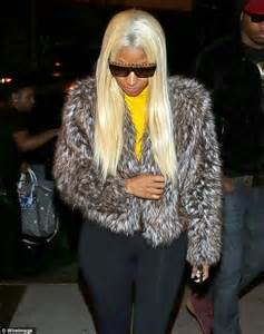 nicki minaj steps out for dinner in unflattering bright yellow polo neck jumper and fur jacket