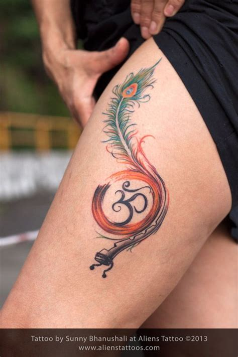 tattooed heart flute peacock feather with flute and om tattoo concept design