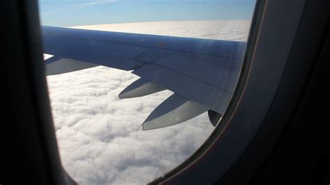 airplane window seat view airplane window seat view of wing of plane on flight