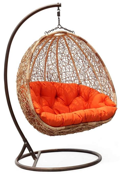 wicker swinging chair wicker swing chair with orange cushion pretty things for
