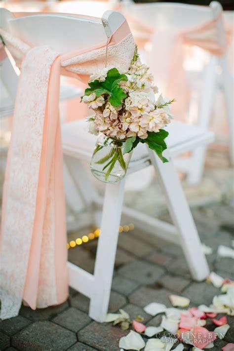 wedding styling ideas aisle decor lace  peach ribbon