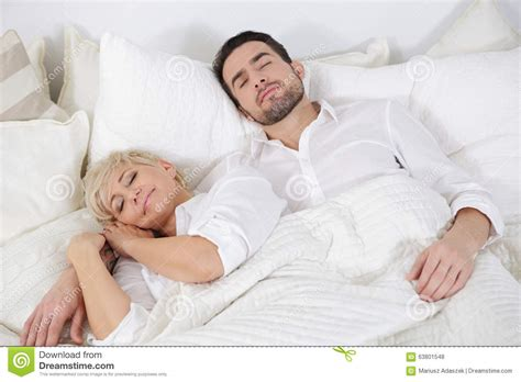 how to get a woman in bed man and woman in bed stock photo image 63801548
