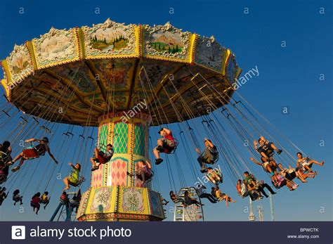 spinning swing ride children on the antique spinning swing ride at sunset at