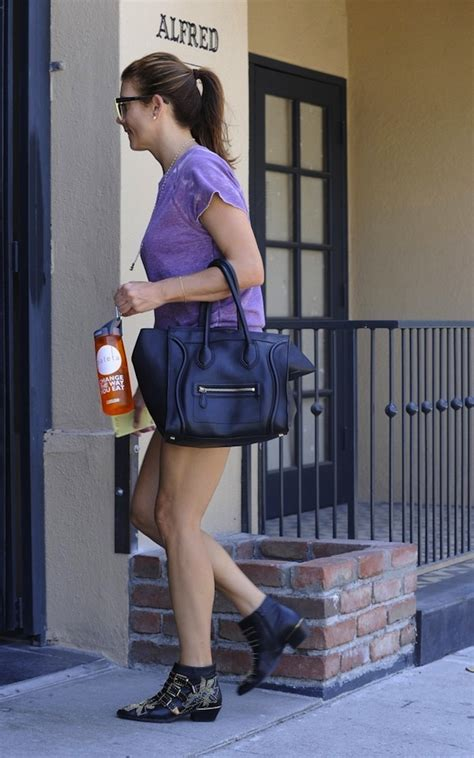 Name That Purse Kate Walsh by Kate Walsh Carrying Luggage Bag And Wearing