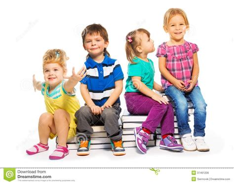 who is the little kid in the new geico commercial group of kids sitting on the books stack royalty free