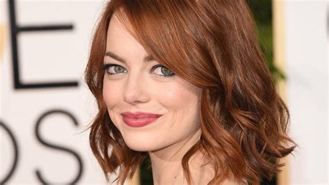 emma stone s hair isn t red see her new dark hair blunt