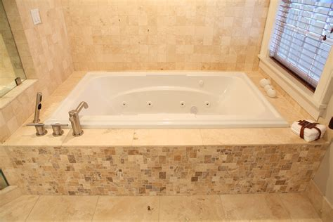 stone bathtub surround mosaic tile and lime stone tub surround fink builders