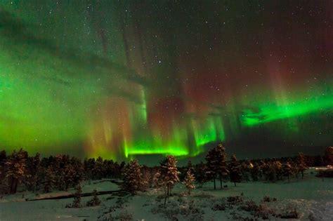 northern lights resort finland magnificent aurora borealis display over kakslauttanen