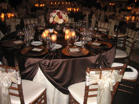 flowers reception pink orange brown wedding gold roses candles table centerpieces