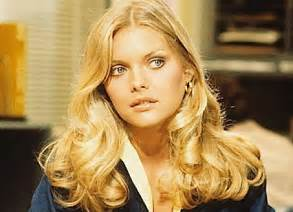Michelle pfeiffer her name is in two of the hottest pop songs on the