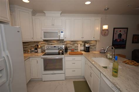 white cabinets with river white granite white river white traditional kitchen other metro