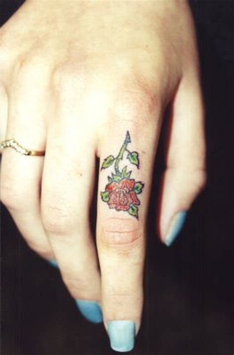 rose tattoo on your finger 33 beautiful rose finger tattoos