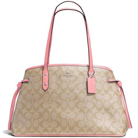 Coach Signature Pink Large spreesuki coach drawstring carryall in signature coated canvas light khaki brown blush pink