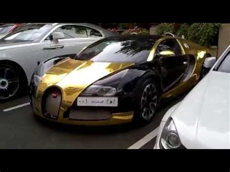 bugatti gold and black black gold bugatti veyron and white lamborghini