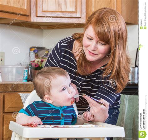 Kitchen Baby Feeds Baby In Kitchen Stock Photo Image 47468697