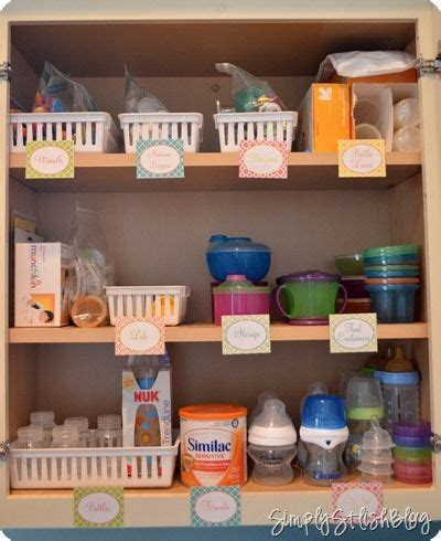 how to organize mugs in cabinet organize baby cabinet bottles sippy cups snack holders