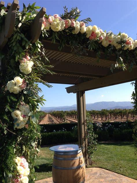 rustic gazebo wedding arch olive branches  ivy