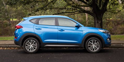 Compare Kia Models Medium Suv Comparison Hyundai Tucson Active X V Kia