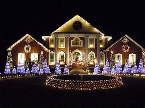beautiful light display on large mansion pictures photos