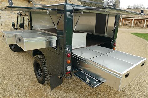 Awning Uk Defender 130 Camelbac With Storage Drawers
