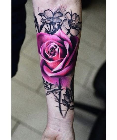 elegant forearm rose flower tattoo with branches dinga