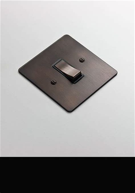 electrical light fittings switches and sockets in bronze