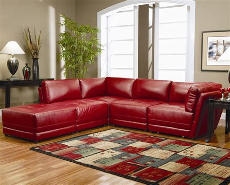 red and brown sofa colorful carpet and brown sidetable close to red sofa set