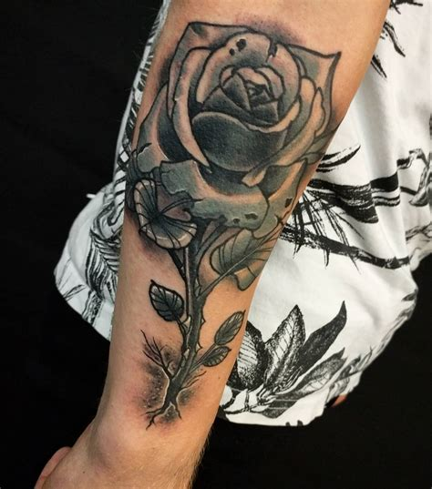 rose growing from concrete tattoo ollie keable tattoos out of concrete thanks