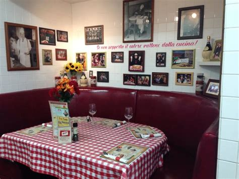 buca di beppo kitchen table reservations original and table with the view of the kitchen