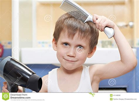 how to comb a boys hair little boy with a comb and hair dryer stock image image