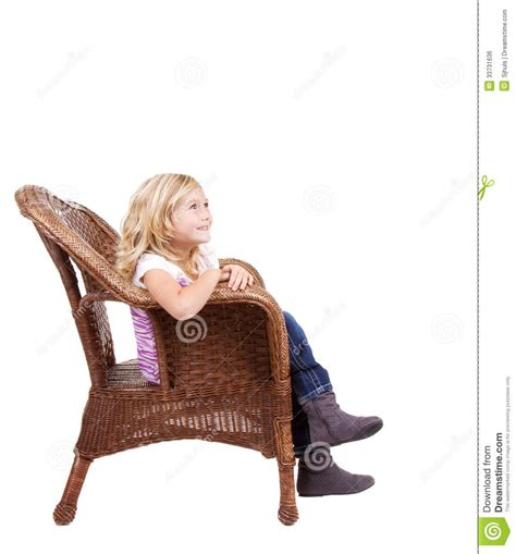 little girl on chair little girl sitting on a chair royalty free stock image