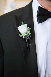 groom s boutonniere boutonnieres photos white boutonniere on groom s lapel inside weddings
