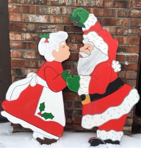 christmas kiss wallpaper christmas kiss under the mistletoe with santa and the mrs