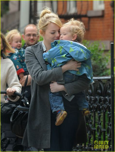emma stone child emma stone carries andrew garfield s nephews photo