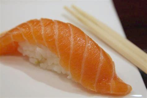 Salmon Sushi file salmon nigiri sushi with chopsticks 2008 jpg wikimedia commons