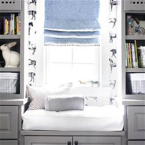 window seat flanked by bookcases white and blue boy nursery with l shaped bookcase
