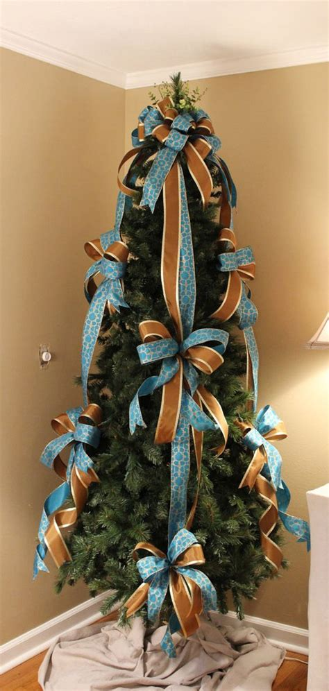 criss cross ribbon with bows on christmas tree ribbons tree bows and trees on