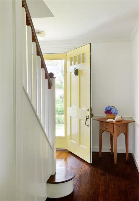 yellow foyer yellow front door country entrance foyer
