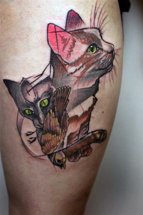 tattoo artist named cat this abstract illustration tattoo shows two cats and a