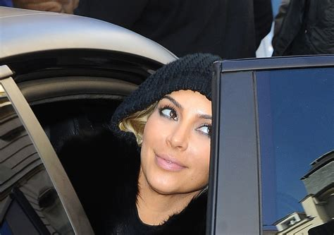 kim kardashian updates platinum hair color in paris kim kardashian looks a little different with new platinum